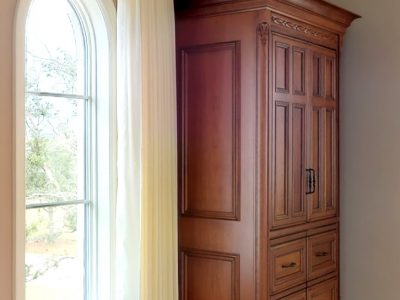 European Estate Armoire custom made fine furniture in cherry wood in amber stain with silky smooth, waxed finish