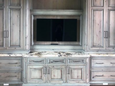 European Estate Study Cabinets woodwork in a weathered driftwood stain on knotty alder