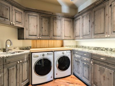 Laundry Room driftwood gray stain on Knotty Alder cabinets